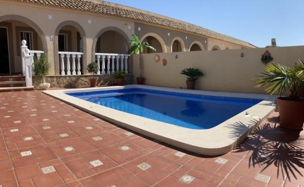Stunning corner bungalow with pool